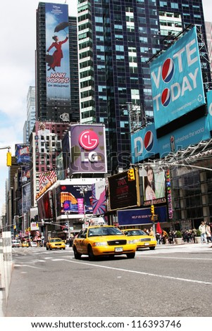 NEW YORK CITY - APR 18: Times Square, famous tourist attraction featured with Broadway Theaters and famous restaurant and store locations in New York City, April 18, 2010 in Manhattan, New York City. - stock photo