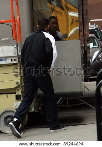 NEW YORK CITY - APRIL 15: Actor Will Smith checks himself out in a mirror of his trailer on the set of Men In Black 3 (MIB3) which is being filmed in New York, NY on April 15, 2011.