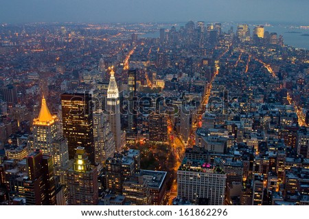 NEW YORK CITY - APRIL 20: Aerial view of Manhattan by night, one of the most touristic places in the city, on April 20, 2011, in New York City, USA. - stock photo