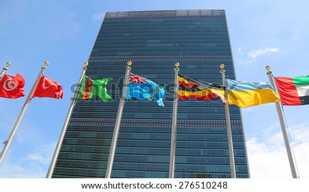 NEW YORK CITY - APRIL 30, 2015: International Flags in the front of United Nations Headquarter in New York