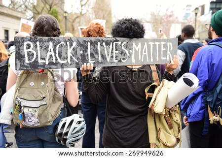 NEW YORK CITY - APRIL 14 2015: several hundred activists from Stop Mass Incarceration Network rallied at Union Square Park before marching to Lower Manhattan. - stock photo