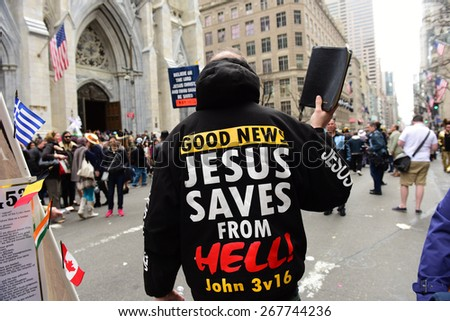 NEW YORK CITY - APRIL 5 2015: thousands of New Yorkers filled 5th Avenue marking Easter Sunday with the tradition Easter Bonnet Parade, a tradition dating from the 1870s. Christian evangelists - stock photo