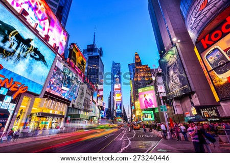 NEW YORK CITY - APRIL 9, 2013: Times Square crowds and traffic at night. The site is regarded as the world's most visited tourist attraction with nearly 40 million visitors annually. - stock photo