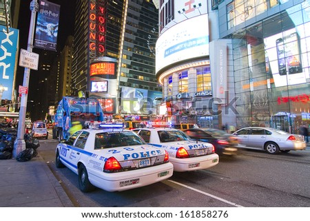 NEW YORK CITY - APRIL 19: Times Square is a busy tourist intersection of neon art and commerce and is an iconic place of New York City and USA, on April 19, 2011 in Manhattan, New York City. - stock photo