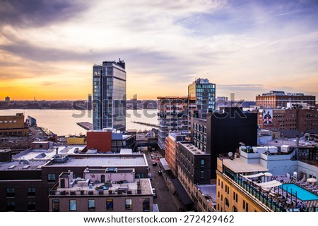 NEW YORK CITY - APRIL 6, 2015:  View across Manhattan Meatpacking District and Chelsea from above, at sunset with The Standard Hotel in view.  - stock photo