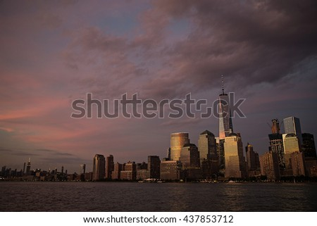 New York City at dusk under dark, purple sky - stock photo