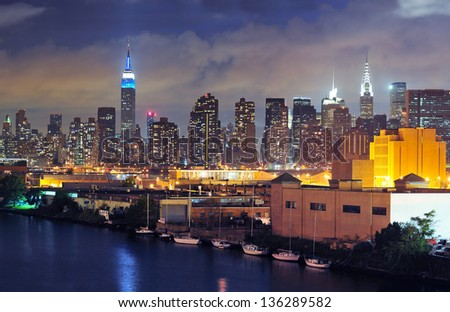 New York city at dusk with the Midtown Skyline visible beyond Queens - stock photo