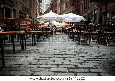 NEW YORK CITY - AUG. 3, 2014:  View of outdoor dining area on historic Stone Street in the Financial District in lower Manhattan. - stock photo