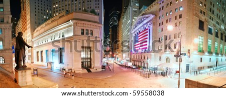 """NEW YORK CITY - AUG 8: Wall Street, a metonym for the """"influential financial interests"""" of the American financial industry, panorama view at night. August 8, 2010 in Manhattan, New York City. - stock photo"""