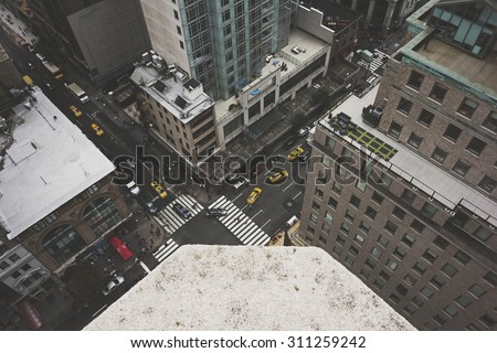 NEW YORK CITY - August 22:  A bustling New York City street scene taken from above on August 22, 2015.  Matte finish applied. - stock photo