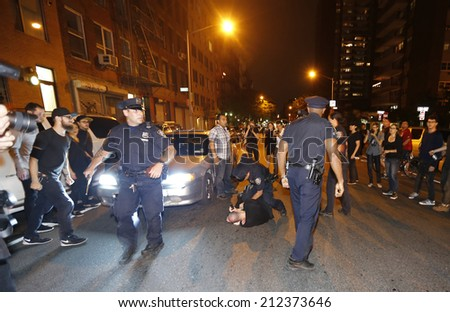 NEW YORK CITY - AUGUST 20 2014: Activists supporting Ferguson gathered at Sara Roosevelt Park before marching through the Lower East Side with two arrests by NYPD before ending up in Union Square. - stock photo
