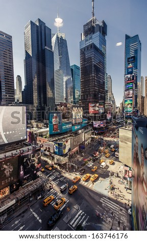 NEW YORK CITY - AUGUST 13: Aerial view of Times Square, is a busy tourist intersection of neon art and commerce and is an iconicplace of New York City on August 13, 2013 in Manhattan, New York City. - stock photo