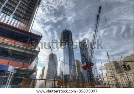 NEW YORK CITY - AUGUST 29: Ongoing construction on the World Trade Center August 29, 2011 in New York, NY. Once completed it will be the tallest skyscraper in the USA. - stock photo