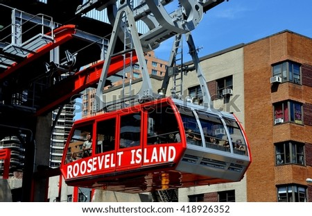New York City - August 31, 2011: Roosevelt Island tram filled with passengers departing the Second Avenue and East 59th Street station following its crossing of the East River to Manhattan