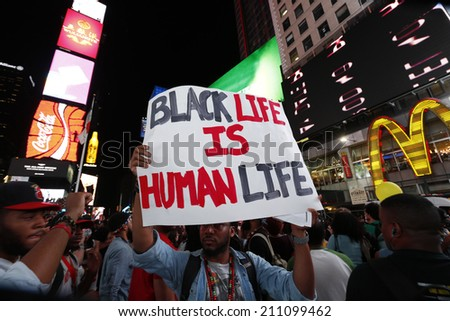 NEW YORK CITY - AUGUST 14 2014: Thousands of New Yorkers responded to Anonymous's call for a Day of Rage march & rally to demand justice for the police-related deaths of Michael Brown & Eric Garner - stock photo