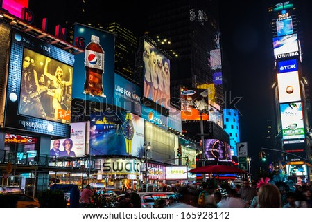 NEW YORK CITY - AUGUST 12: Times Square, is a busy tourist intersection of neon art and commerce of New York City and USA at night on August 12, 2013 in Manhattan, New York , NY  - stock photo