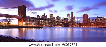 New York City Brooklyn bridge and Manhattan skyline night scene - stock photo