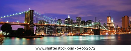 New York City Brooklyn bridge and Manhattan skyline night scene over Hudson River - stock photo