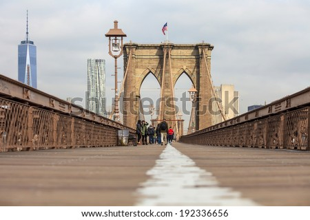 New York City Brooklyn Bridge in Manhattan with skyscrapers and city skyline over Hudson River. - stock photo