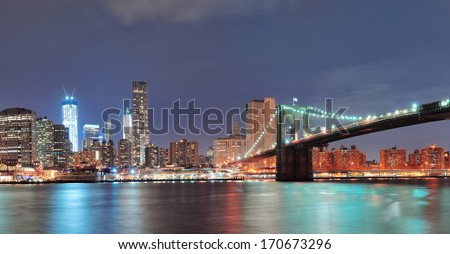 New York City Brooklyn Bridge with downtown skyline over East River. - stock photo