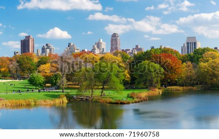 New York City Central Park panorama view in Autumn with Manhattan skyscrapers and colorful trees over lake with reflection. - stock photo