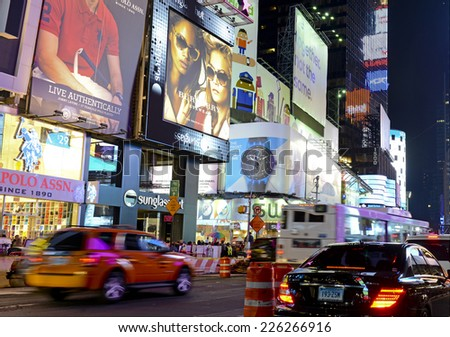 NEW YORK CITY - CIRCA OCTOBER 2014. Constant motion and crowds of people characterize Times Square in Manhattan as Tourists flock to the attractions and bright lights of the Theater District. - stock photo
