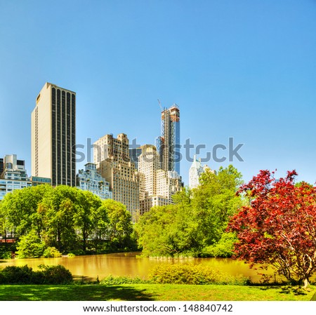 New York City cityscape on a sunny day as seen from Central Park - stock photo