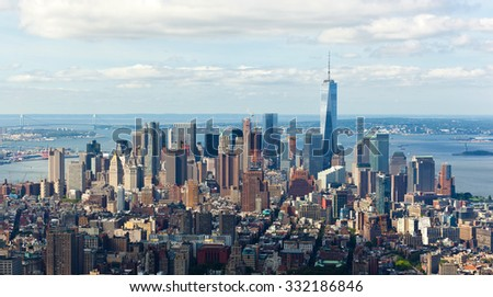 New York City, Cityscape view of Manhattan with skyscrapers and blue sky by day.
