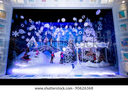 "NEW YORK CITY - DEC. 2:  Spectators view holiday window display in NYC on Dec. 2, 2011.  This year's windows are inspired by a partnership with ""Make A Wish Foundation."" - stock photo"