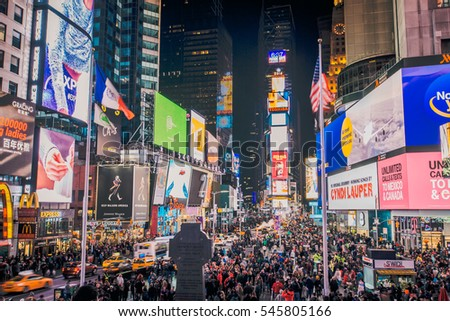 NEW YORK CITY - DEC 3: Times Square, featured with Broadway Theaters and animated LED signs, is a symbol of New York City and the United States, DEC 3, 2016 in Manhattan, New York City.