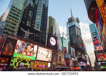 NEW YORK CITY - DEC 2: Times Square ,is a busy tourist intersection of neon art and commerce and is an iconic street of New York City and America, December 2, 2013 in Manhattan, New York City. - stock photo
