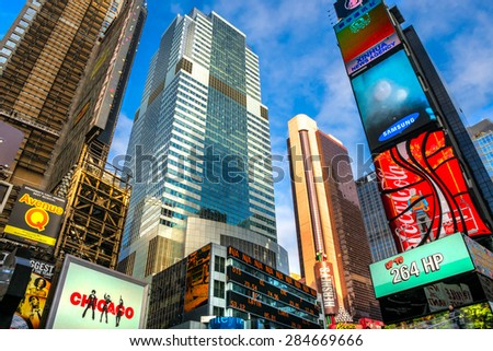 NEW YORK CITY - DEC 01 Times Square ,is a busy tourist intersection of neon art and commerce and is an iconic street of New York City and America, December 01th, 2013 in Manhattan, New York City. - stock photo