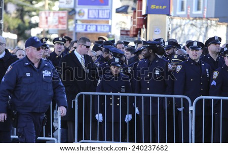 NEW YORK CITY - DECEMBER 26 2014: a viewing for slain NYPD patrolman Rafael Ramos was held at Christ Tabernacle Church in Glendale, Queens. NYPD officers await viewing - stock photo