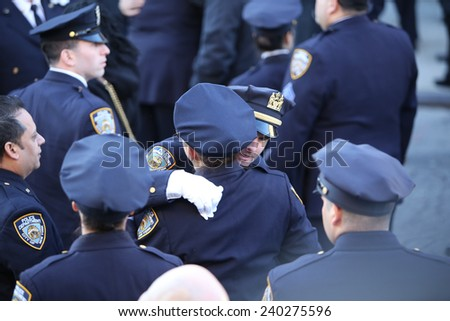 NEW YORK CITY - DECEMBER 27 2014: along with political leaders, uniformed police officers from all over north America attended funeral services for slain NYPD officer Rafael Ramos - stock photo