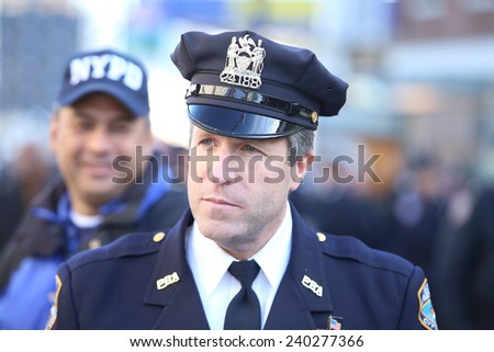 NEW YORK CITY - DECEMBER 27 2014: along with political leaders, uniformed police officers from all over north America attended funeral services for NYPD officer Rafael Ramos. PBA head Patrick Lynch - stock photo