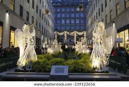 NEW YORK CITY- DECEMBER 18: Angel Christmas Decorations and Christmas Tree at the Rockefeller Center in Midtown Manhattan on December 18, 2014 - stock photo
