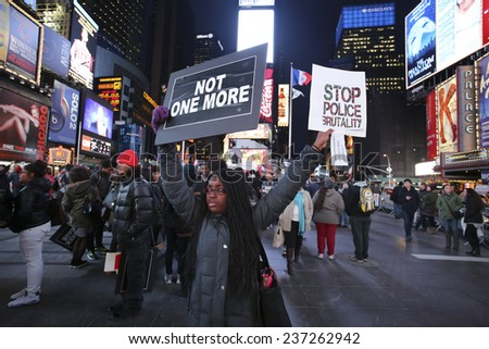 NEW YORK CITY - DECEMBER 12 2014: Carry the Names staged a rally in Times Square where 60 activists held signs naming people killed or injured by law enforcement - stock photo