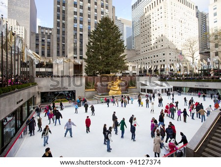 NEW YORK CITY - December 17: People enjoying Rockefeller Center Ice Skating at Christmas with the famous Christmas tree on December 17th, 2011 in New York City, New York. - stock photo