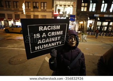 NEW YORK CITY - DECEMBER 30 2015: Several hundred activists gathered in Union Square for a candlelight vigil in memory of Sandra Bland, arrested for a minor traffic violation later found hanged. - stock photo