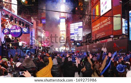 NEW YORK CITY - DECEMBER 31 2013: The Times Square Alliance hosted the square's 110th New Year's Eve countdown with celebrities, crowds & cold temps, Culmination of the countdown & the start of 2014 - stock photo