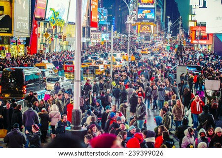 NEW YORK CITY - DECEMBER 20: Times Square crowds at night on December 20, 2014 in Midtown of Manhattan, New York City, USA. It is the last Saturday before Christmas.  - stock photo