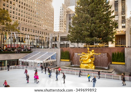 NEW YORK CITY - DECEMBER 4, 2015:   View at historic Rockefeller Plaza in Manhattan during the Christmas season with Christmas Tree and skaters. - stock photo