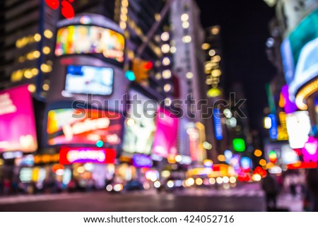 New York City defocused blur of Times Square lit up at night - stock photo