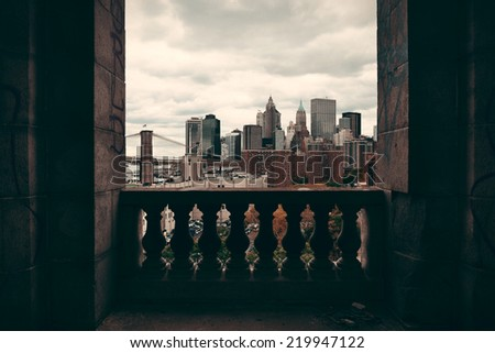 New York City downtown architecture skyline through abandoned balcony. - stock photo