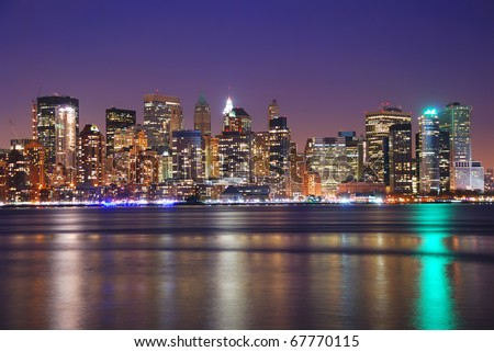 New York City Downtown at night over Hudson River with reflections. - stock photo