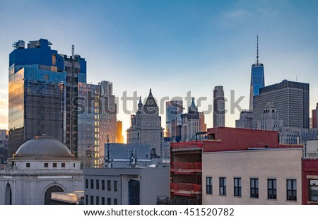 New York City Downtown Skyline at Sunset in Manhattan - stock photo