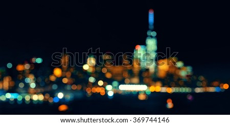 New York City downtown skyline out of focus bokeh panorama at night - stock photo
