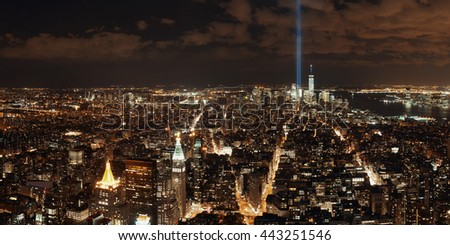 New York City downtown skyline panorama night view with September 11 tribute light.. - stock photo