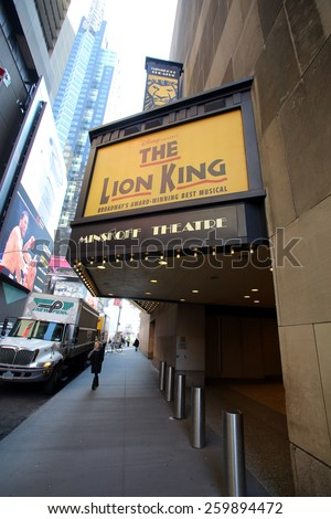 NEW YORK CITY - FEB. 25, 2015:  Pedestrians walk past the Minskoff Theater, home of Disney's Broadway play, The Lion King. 