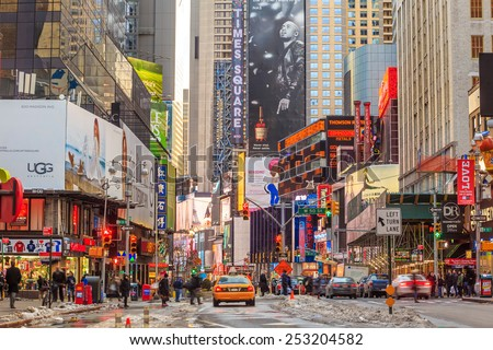 NEW YORK CITY - FEB 11: Yellow taxi cabs and glowing electric signs at Broadway and Times Square on February 11, 2015 in Manhattan, New York City. - stock photo